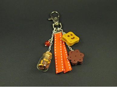 Bijou de sac aux biscuits croquants et mini fiole de verre