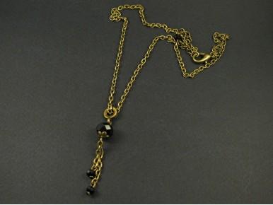 Collier fantaisie couleur bronze avec des perles facettées noires