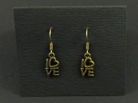 Boucles d'oreille couleur bronze avec l'inscription love