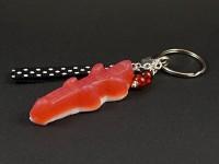 Porte-clé gourmand représentant un bonbon gélifié crocodile rouge