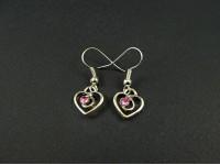 Boucles d'oreilles coeurs avec des strass roses