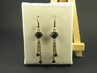Boucles fantaisie aspect bronze avec perles facettées noires