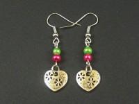 Boucles d'oreilles dynamiques avec des perles de verre nacrées vertes et fuchsia