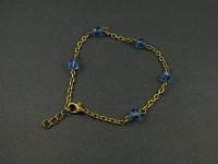 Bracelet fantaisie couleur bronze avec des perles de verre facettées bleues