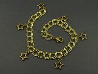 Bracelet en métal fantaisie couleur bronze avec des breloques étoiles
