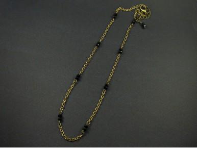 Collier fantaisie couleur bronze agrémenté de perles facettées noires