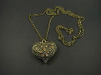 Collier en métal couleur bronze coeur strassé