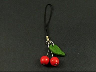 Bijou de téléphone cerises rouges et feuille verte